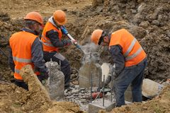 Workers at the construction site chop a jackhammer piles are cut royalty free stock images