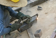 Workers at construction site cutting metal using blowtorch Stock Photography