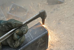 Workers at construction site cutting metal using blowtorch Royalty Free Stock Image