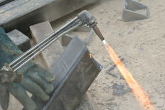 Workers at construction site cutting metal using blowtorch Royalty Free Stock Images