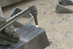 Workers at construction site cutting metal using blowtorch Royalty Free Stock Photo