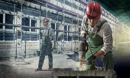 Workers at a construction site Royalty Free Stock Image