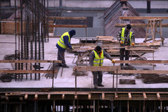 Workers on construction site. Without protection equipment Stock Photos