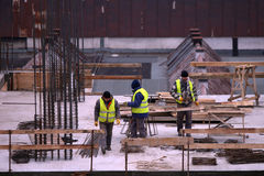 Workers on construction site Royalty Free Stock Image