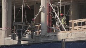 Workers on a construction site stock video footage