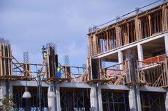 Workers on constructions. Construction of the new house Royalty Free Stock Photos