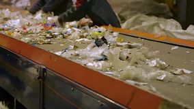 Workers at conveyor sorting garbage. At a recycling plant. Waste sorting. Conveyor for sorting waste. Recycling garbage. Trash workers sorting trash, garbage at stock footage