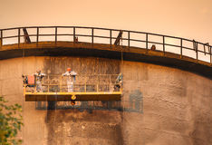 Workers on the cooling tower Stock Photo