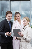 Workers of corporation with tablet Royalty Free Stock Photos