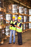 Workers counting pallets. Shipping company workers counting roll steel pallets in warehouse Royalty Free Stock Photos