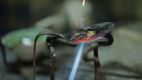 Workers of craftshop melting metal for manufacturing parts for forged products stock footage
