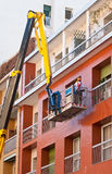 Workers on a crane Royalty Free Stock Image