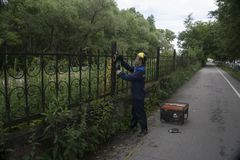 Workers cut away the iron fence - Russia Berezniki 25 Jul 2017 Stock Images