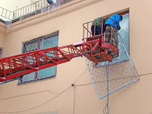 Workers cut lattice with Windows Royalty Free Stock Photography