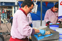 Workers cut up fish for sale at a market  in Delft, Netherlands Stock Images