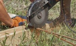 Workers cuts rebar circular saw Stock Photos