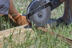 Workers cuts rebar circular saw Stock Photo