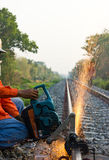 Workers  cutting tracks for maintenance. Royalty Free Stock Images