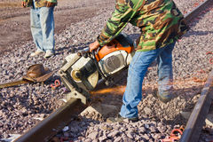 Workers  cutting tracks for maintenance. Royalty Free Stock Photos