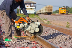 Workers  cutting tracks for maintenance. Royalty Free Stock Photo