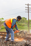 Workers  cutting tracks for maintenance. Stock Image