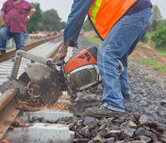 Workers  cutting tracks for maintenance. Royalty Free Stock Photography