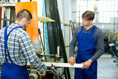 Workers cutting window profiles Royalty Free Stock Photography