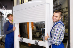 Workers  with different PVC window with shutter Royalty Free Stock Photo