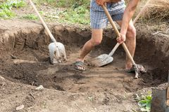 Workers dig a pit for a septic tank. In a private house royalty free stock photo