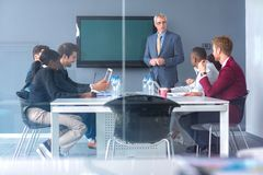 Workers discus about business at meeting royalty free stock image