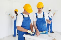 Workers discuss renovation project stock images
