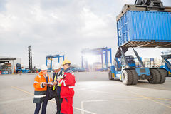 Workers discussing in shipping yard Royalty Free Stock Photography