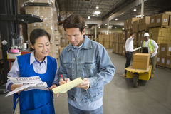 Workers In Discussion At Warehouse Royalty Free Stock Image