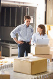 Workers In Distribution Warehouse. Looking at Laptop royalty free stock photos