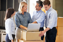 Workers In Distribution Warehouse. Smiling stock photo