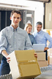 Workers In Distribution Warehouse. Smiling royalty free stock image
