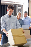 Workers In Distribution Warehouse. Packing royalty free stock photos