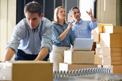 Workers In Distribution Warehouse. Packing royalty free stock photography