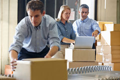 Workers In Distribution Warehouse. Packing royalty free stock photo