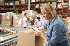Workers In Distribution Warehouse. Packing stock image