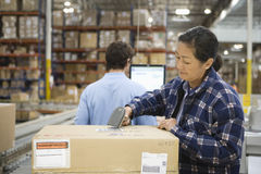 Workers At Distribution Warehouse Royalty Free Stock Images