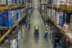 Workers doing their business in storehouse royalty free stock photo