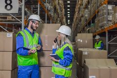 Workers doing their business in storehouse Royalty Free Stock Image