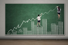 Workers drawing business property graph Stock Images