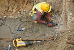 Workers drilling concrete using mobile drilling machine Royalty Free Stock Photo