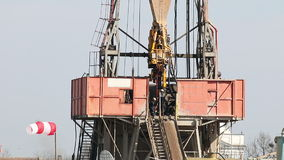 Workers on drilling rig stock video footage