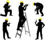 Workers with drills Stock Images
