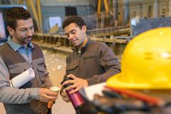 Workers drinking coffee at warehouse. Coleagues stock photos