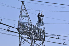 Workers on electricity poles. Workers in electricity - Batalha city - Portugal - Europe Royalty Free Stock Photo