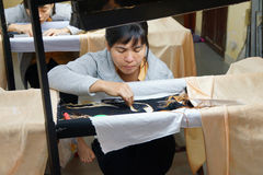 Workers embroider with silk Royalty Free Stock Photos